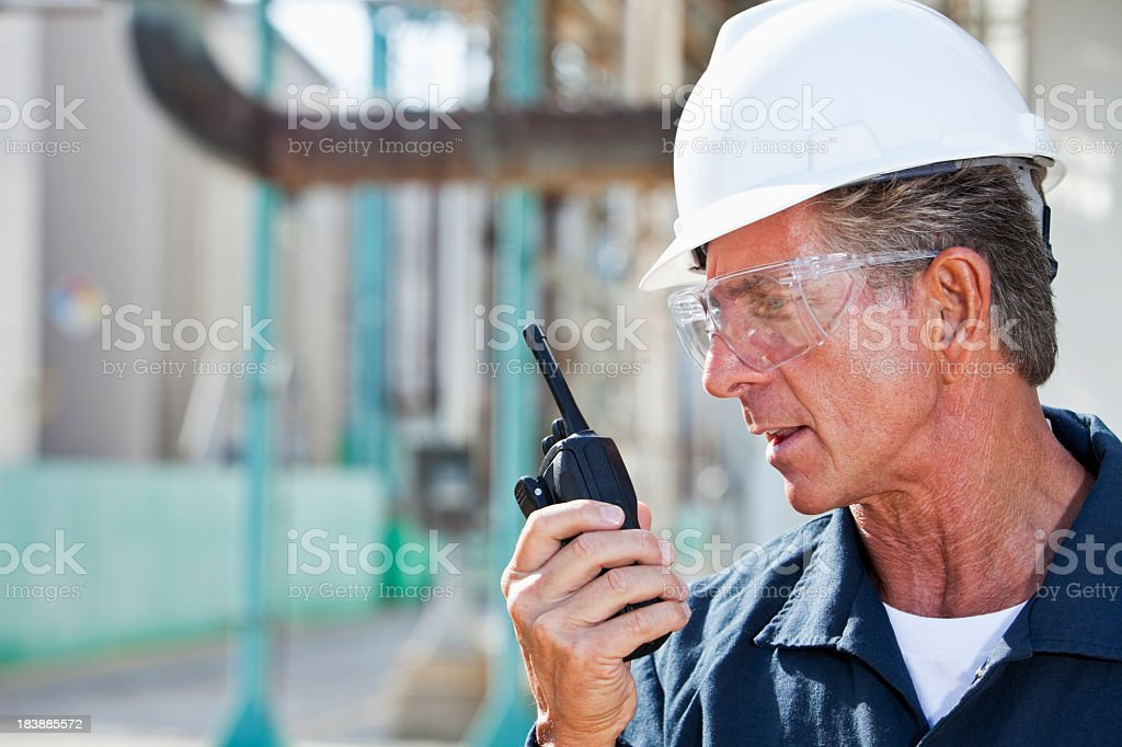 Industrial worker with walkie-talkie royalty-free stock photo