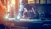 Industrial worker with welding tool
