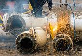 Industrial worker with welding tool