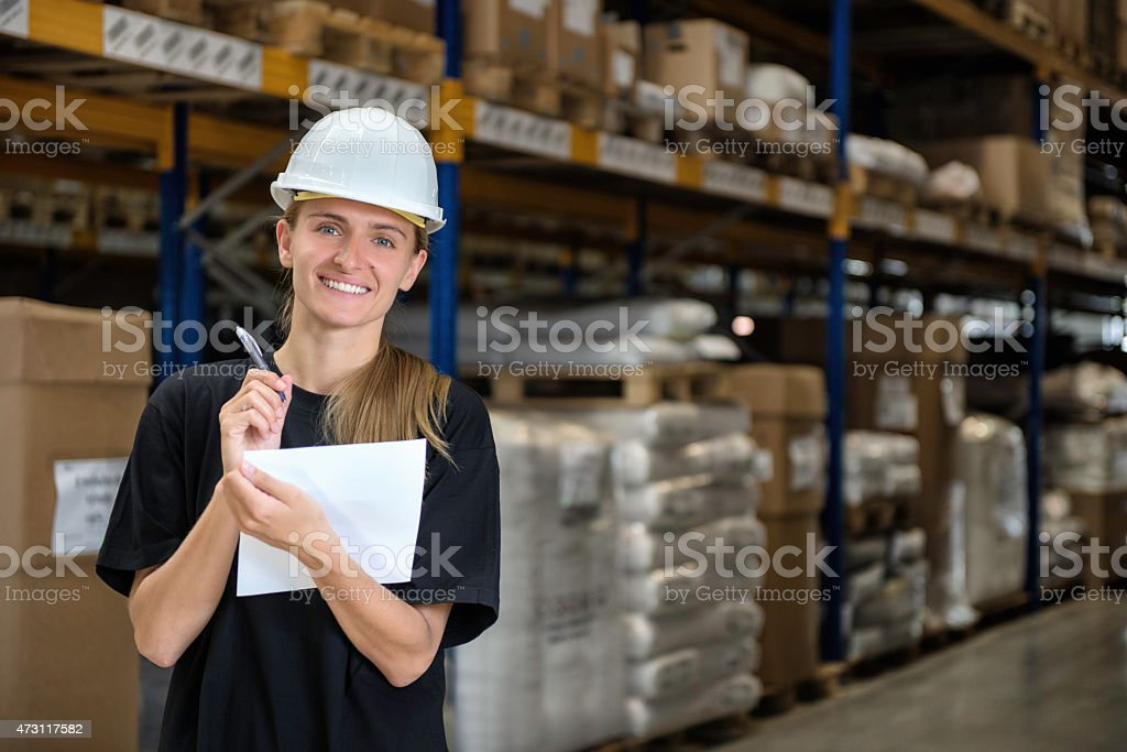 Industrial worker writing on paper stock photo