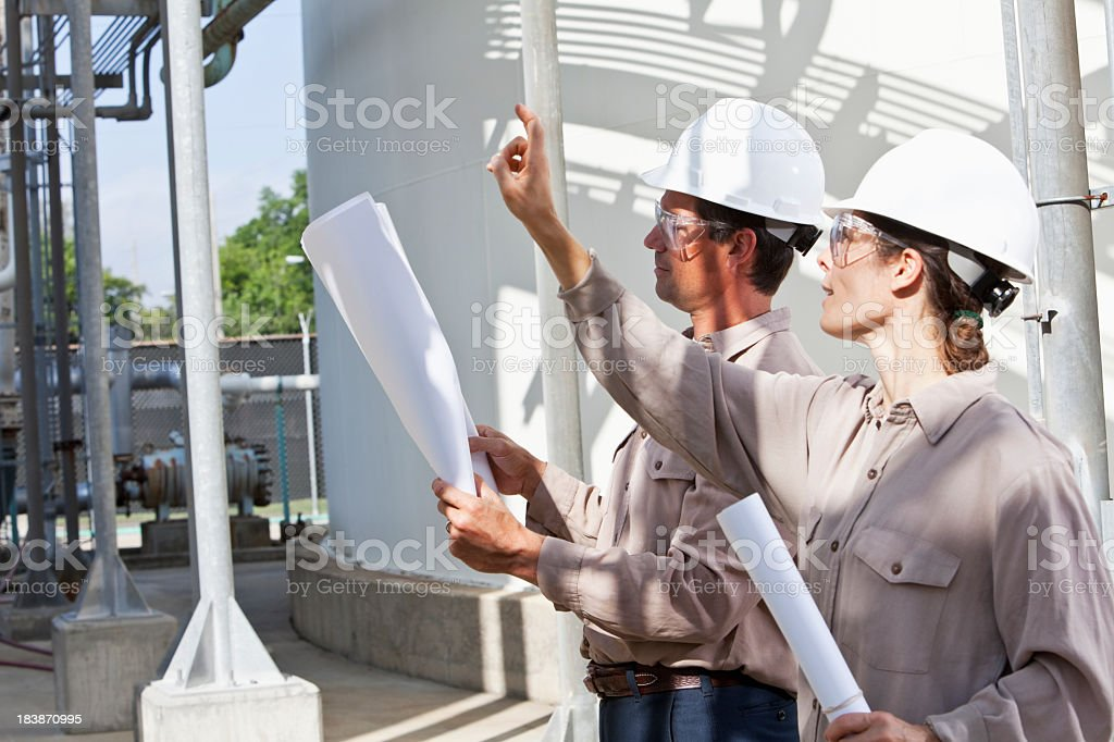 Industrial workers at manufacturing plant royalty-free stock photo