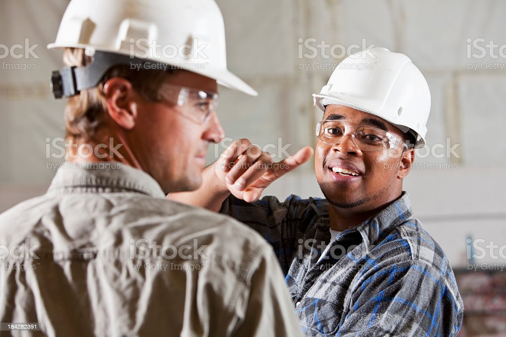 Industrial workers in warehouse stock photo