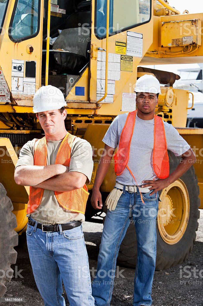 Industrial workers next to crane stock photo