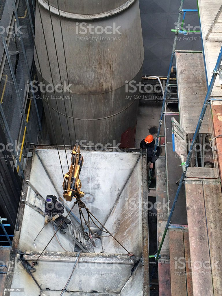 Industrial workers on dismantling stock photo