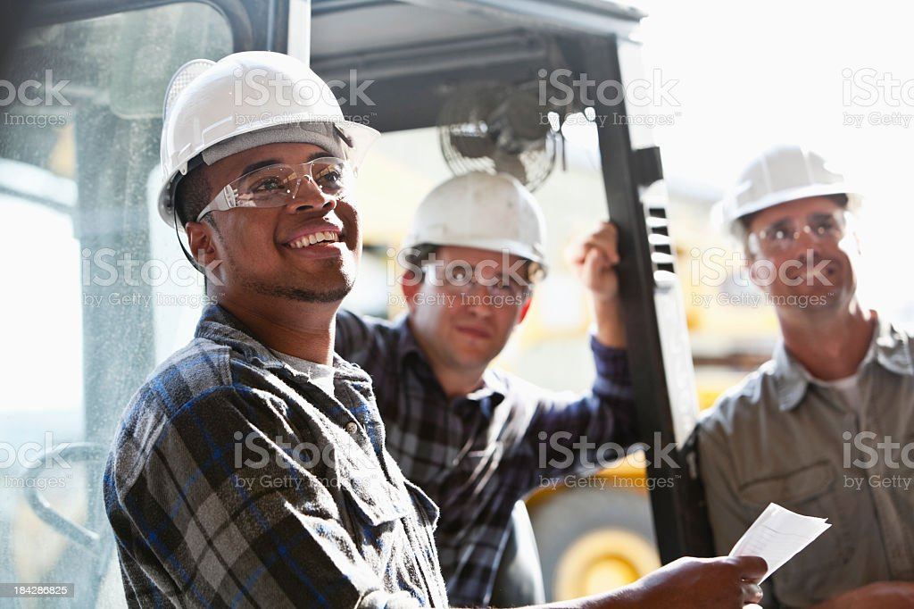 Industrial workers with forklift stock photo