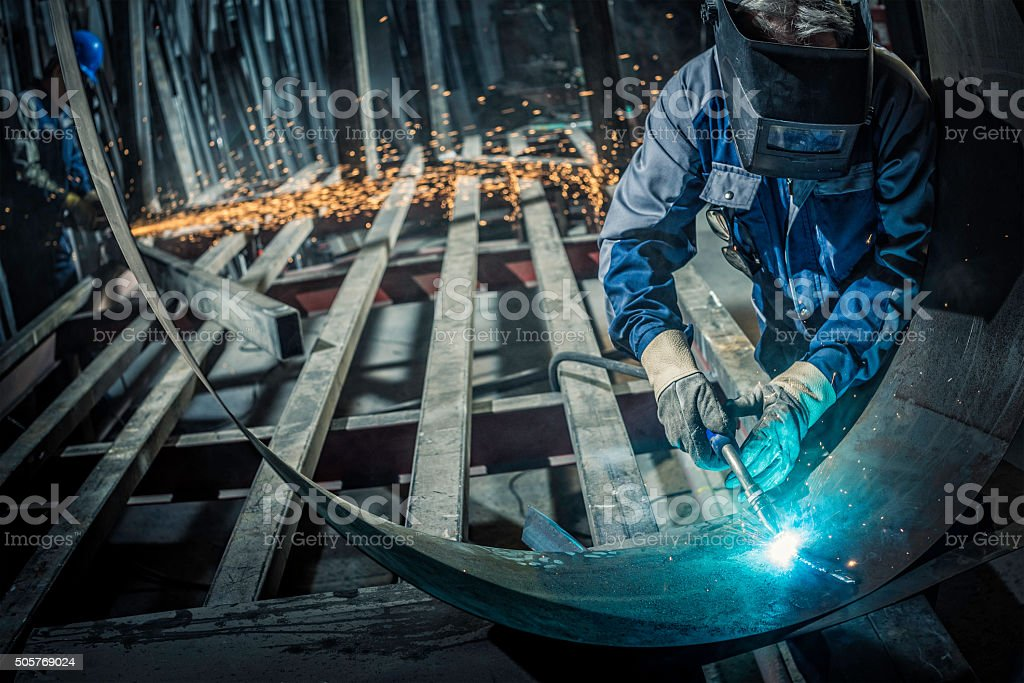 Industrial workers with welding tool stock photo