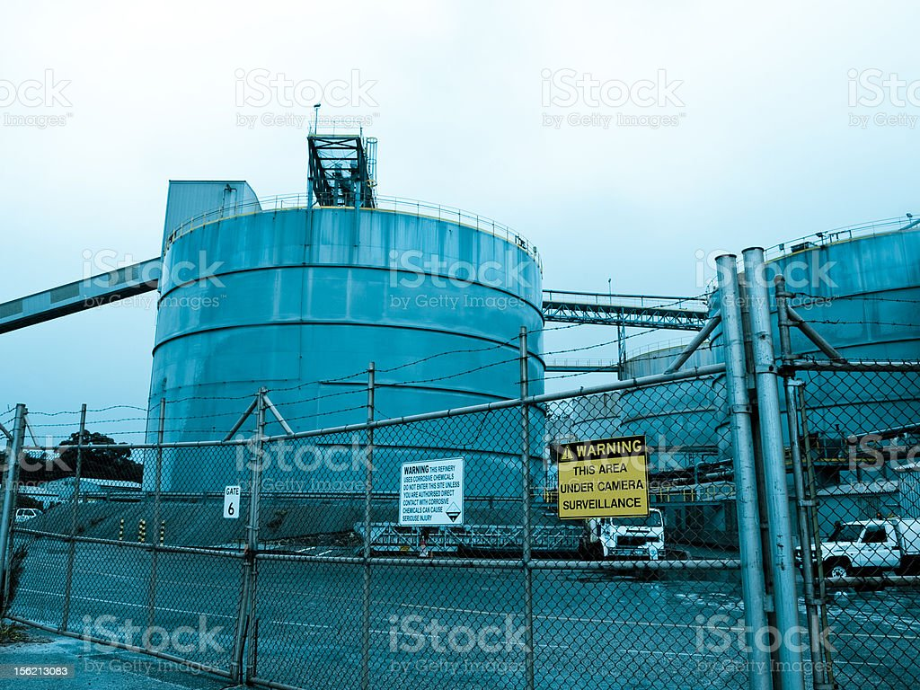 industrial yard behind security fence royalty-free stock photo