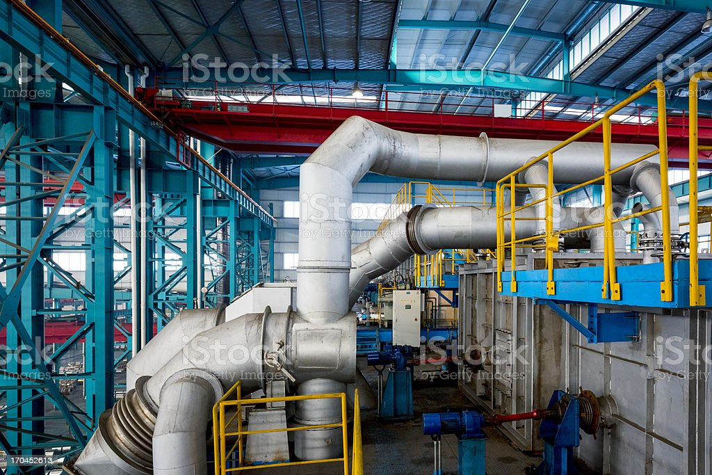 Industrial zone, steel pipelines and cables  in a  plant stock photo