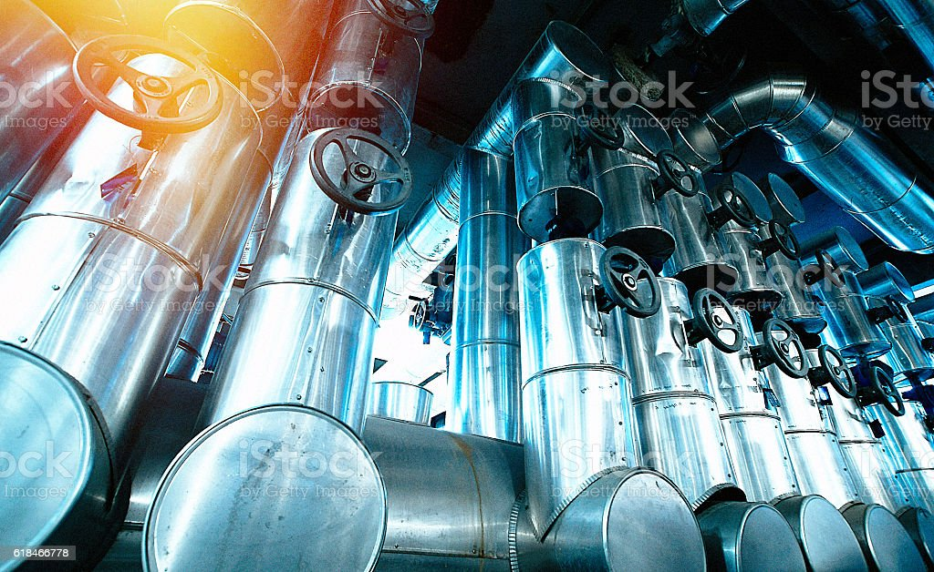 Industrial zone, Steel pipelines and cables in blue tones stock photo