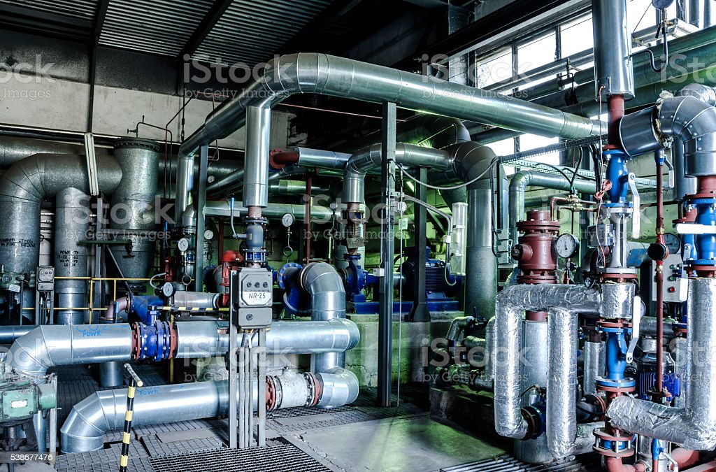 Industrial zone, Steel pipelines and equipment in thermal power stock photo
