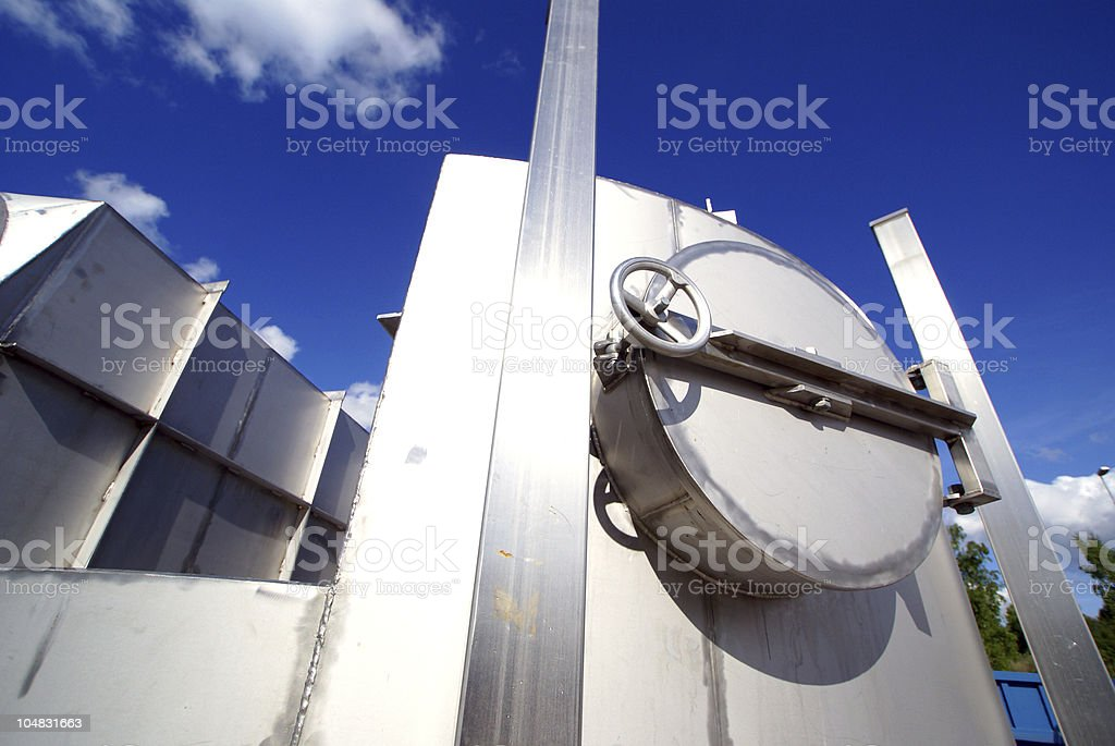 Industrial zone, Steel pipelines and valve on blue sky royalty-free stock photo