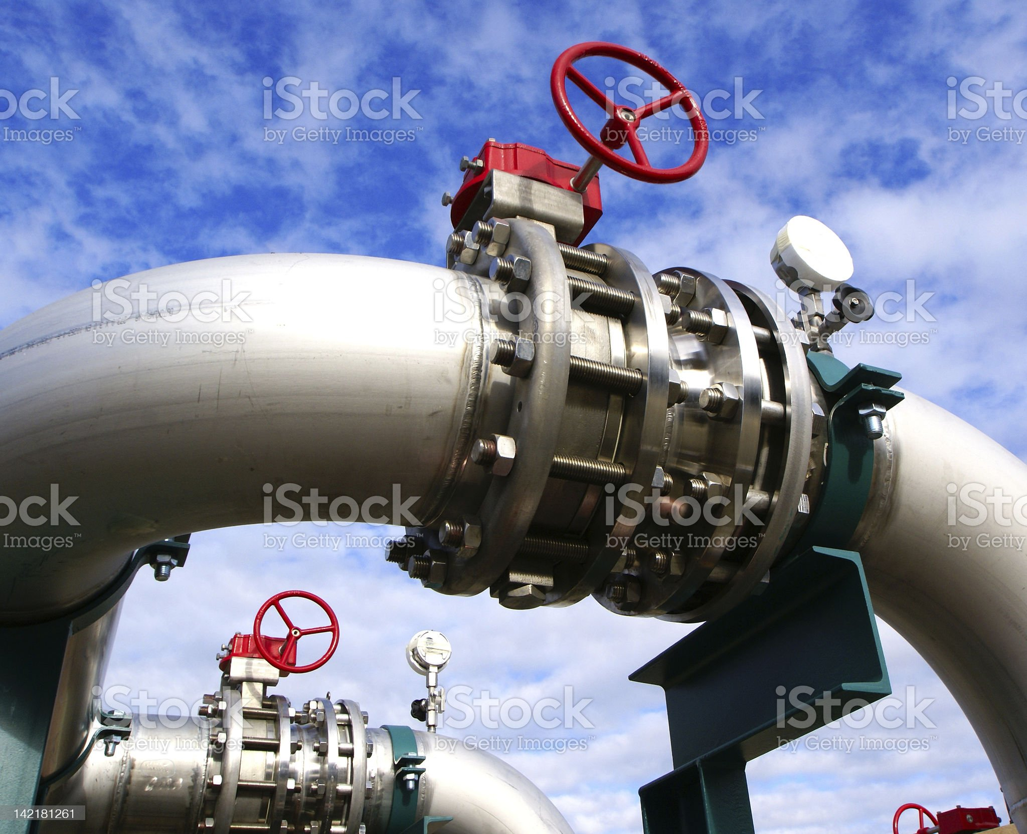 Industrial zone, Steel pipelines and valves against blue sky royalty-free stock photo