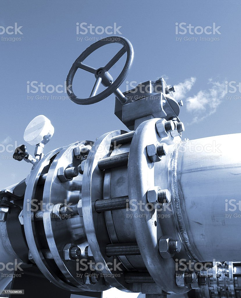 Industrial zone, Steel pipelines and valves in blue tones stock photo