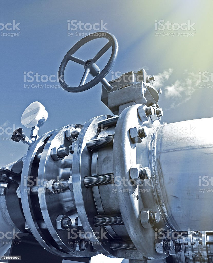 Industrial zone, Steel pipelines and valves n blue tones stock photo
