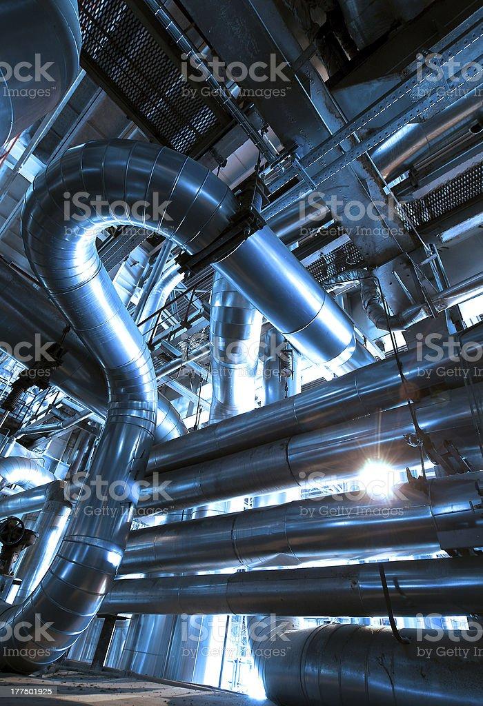 Industrial zone, Steel pipelines in blue tones royalty-free stock photo