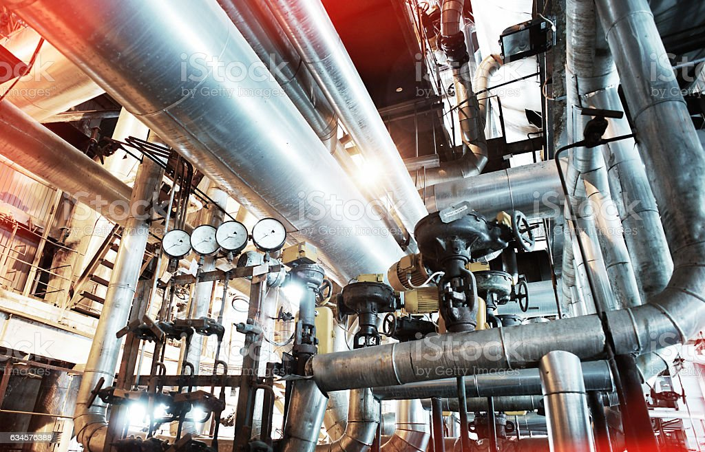Industrial zone, Steel pipelines, valves and ladders stock photo