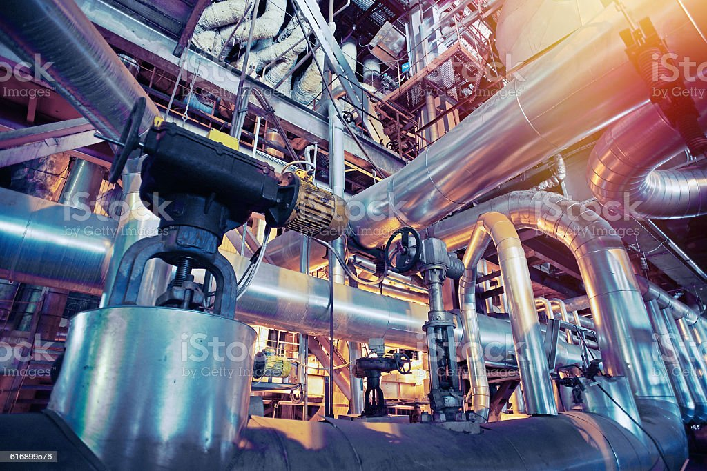 Industrial zone, Steel pipelines, valves and pumps stock photo