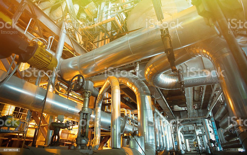 Industrial zone, Steel pipelines, valves and tanks stock photo