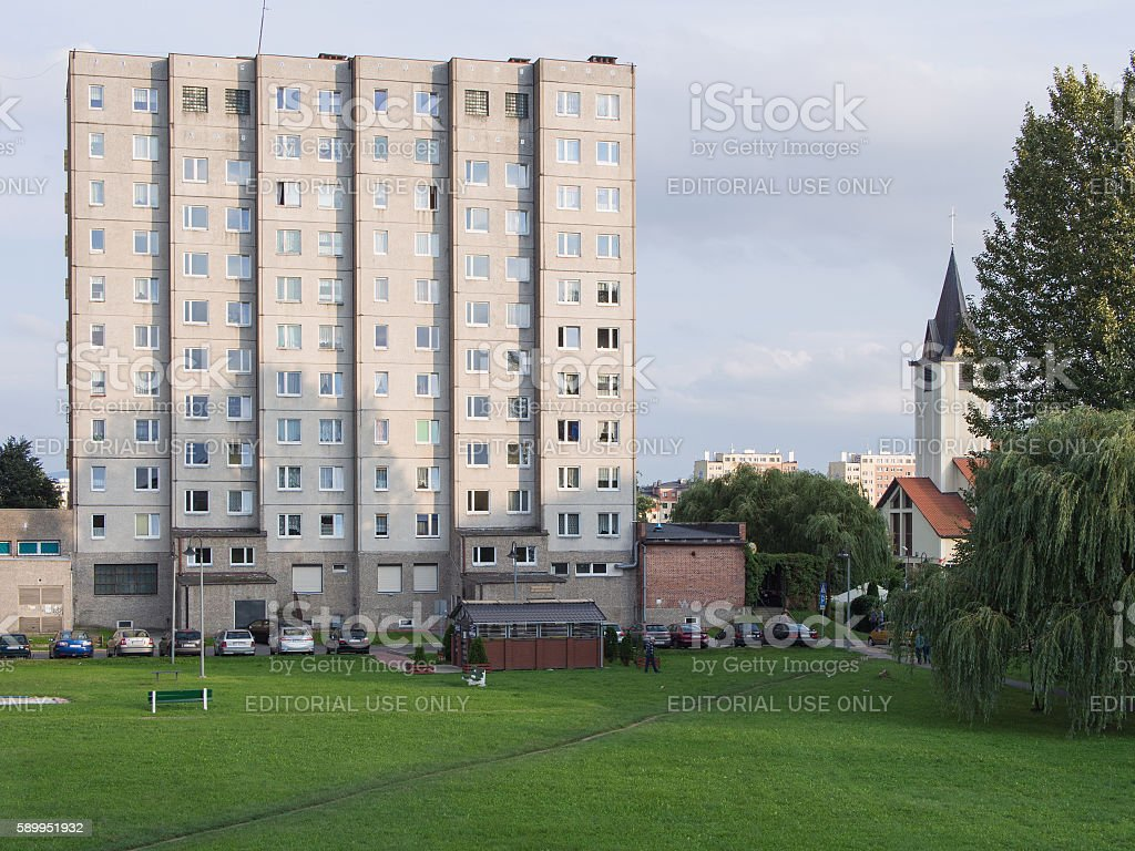 industrialized apartment block with church in Jelenia Gora, Poland stock photo