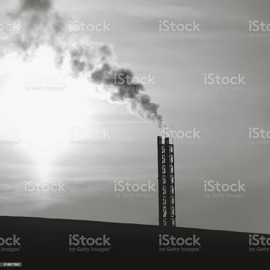Industry and environmental problems - smoke from pipes plant silhouette stock photo