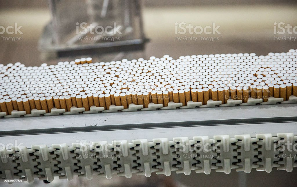 Industry cigarette factory line stock photo