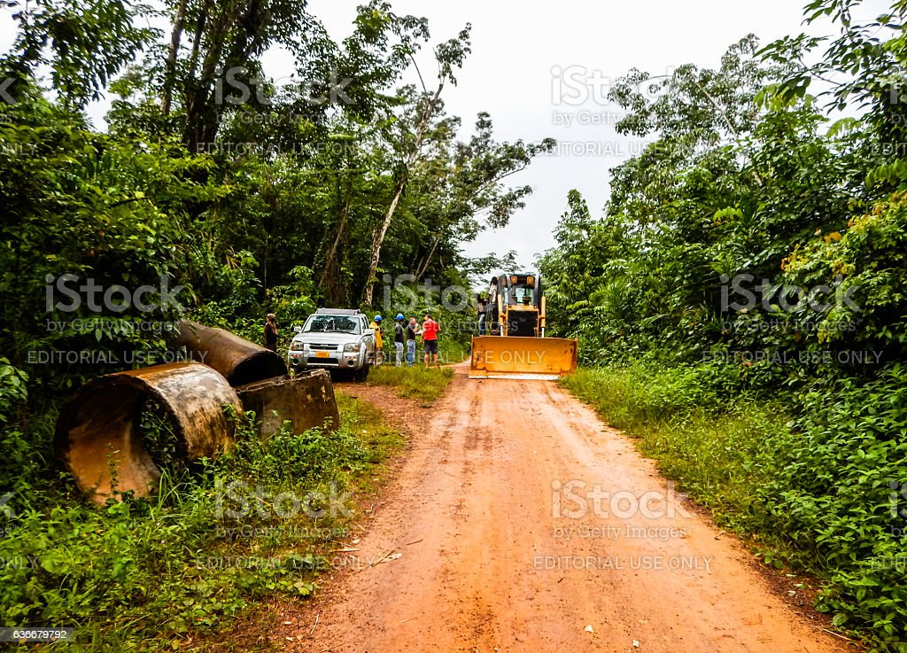 Industry in Liberia. Delivery of equipment through the jungle stock photo