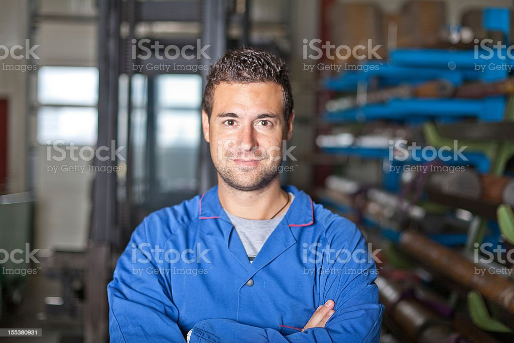 Industry worker with blue workwear royalty-free stock photo