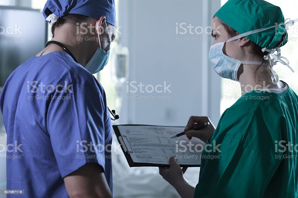 Inexperienced doctor asking questions stock photo