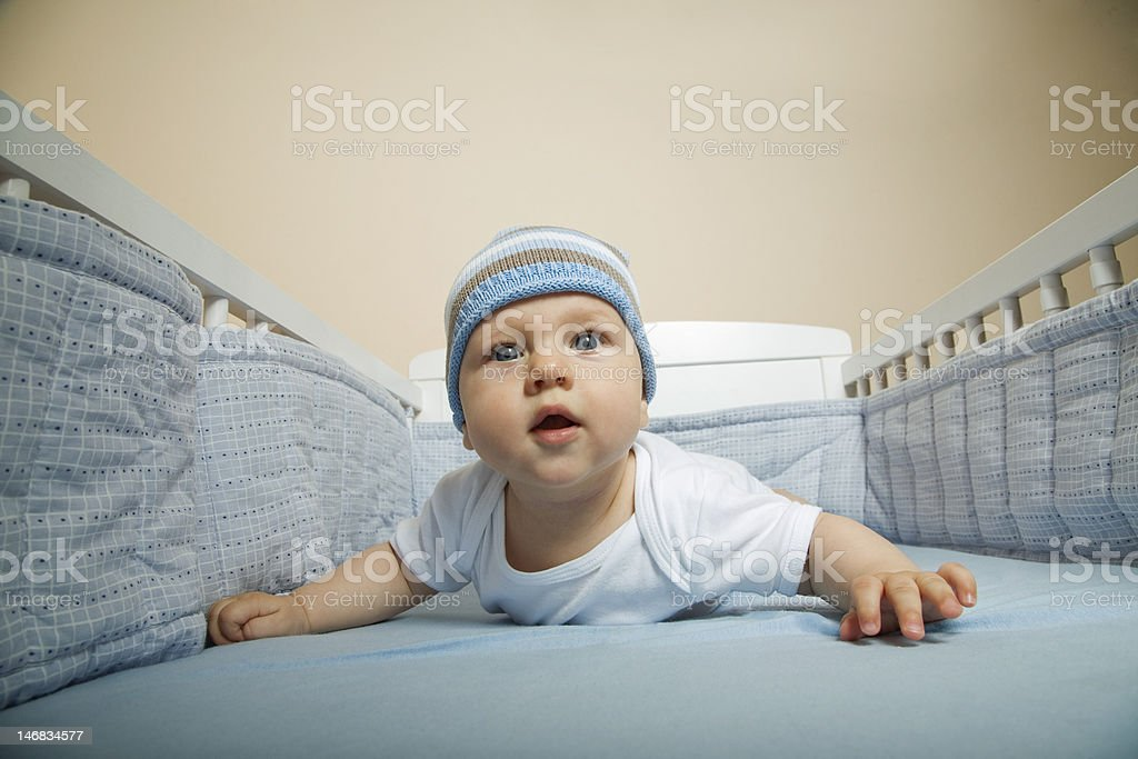 infant baby boy in his bed royalty-free stock photo