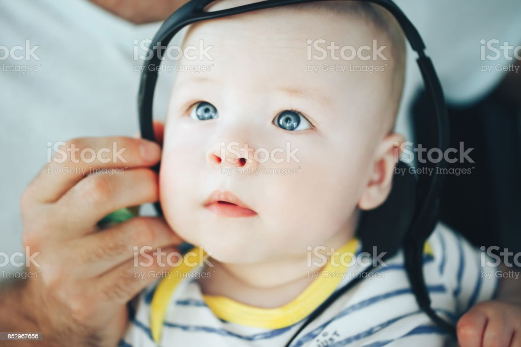 Infant Baby Child Boy Six Months Old with Headphones stock photo
