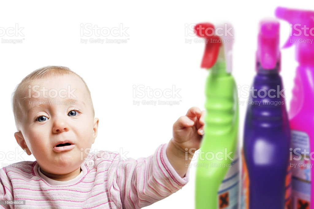 Infant child with cleaning chemicals stock photo