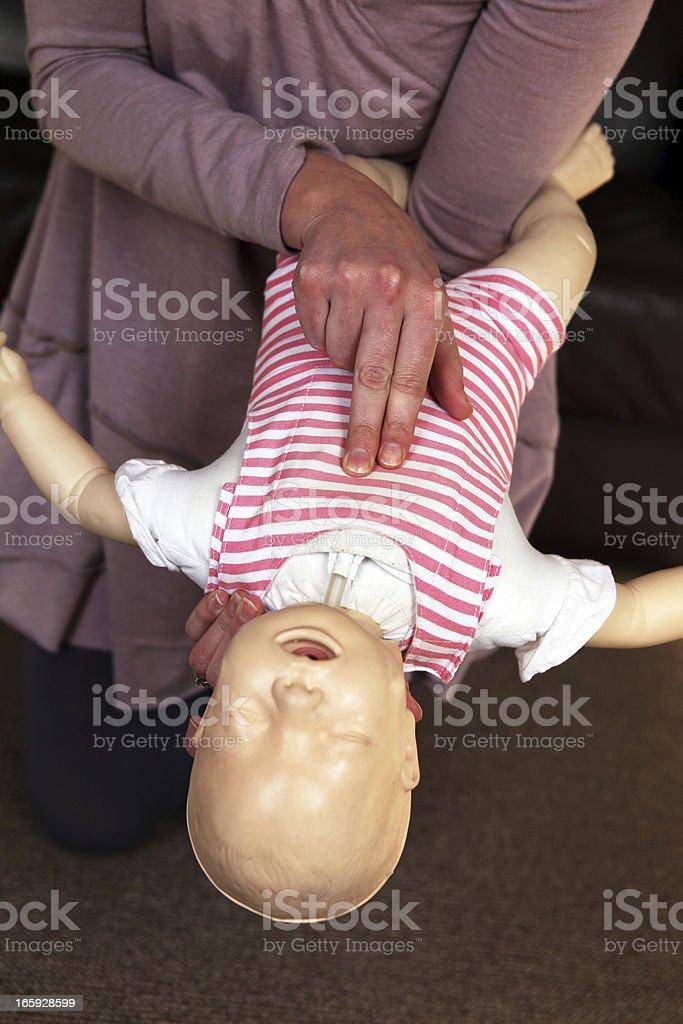 Infant choking training stock photo