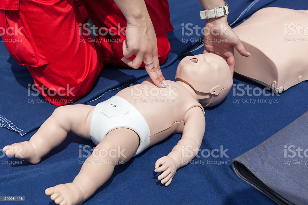 Infant CPR manikin first aid stock photo