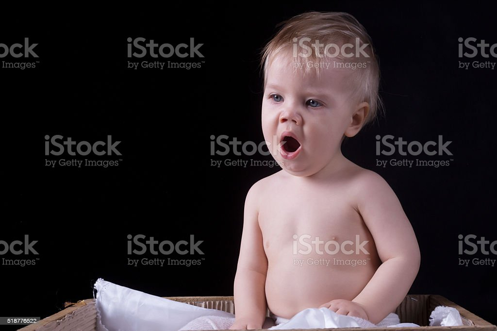 Infant is yawling on a black background stock photo