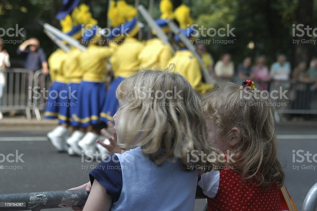 Infant watching cheerleaders near the road stock photo