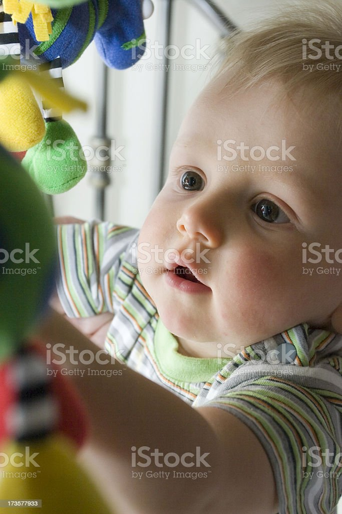 Infant with Toy Mobile royalty-free stock photo