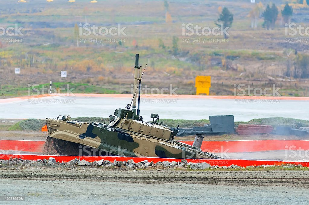 Infantry fighting vehicle after water ford stock photo