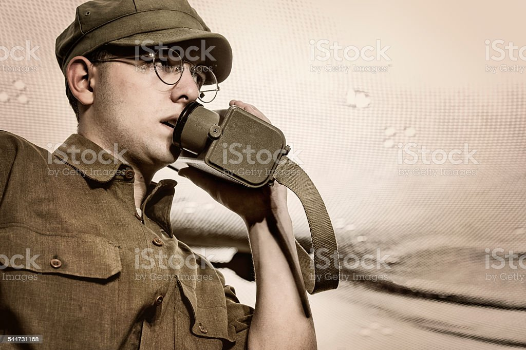 WWII Infantry Man On The Raido Relaying Orders From Command stock photo