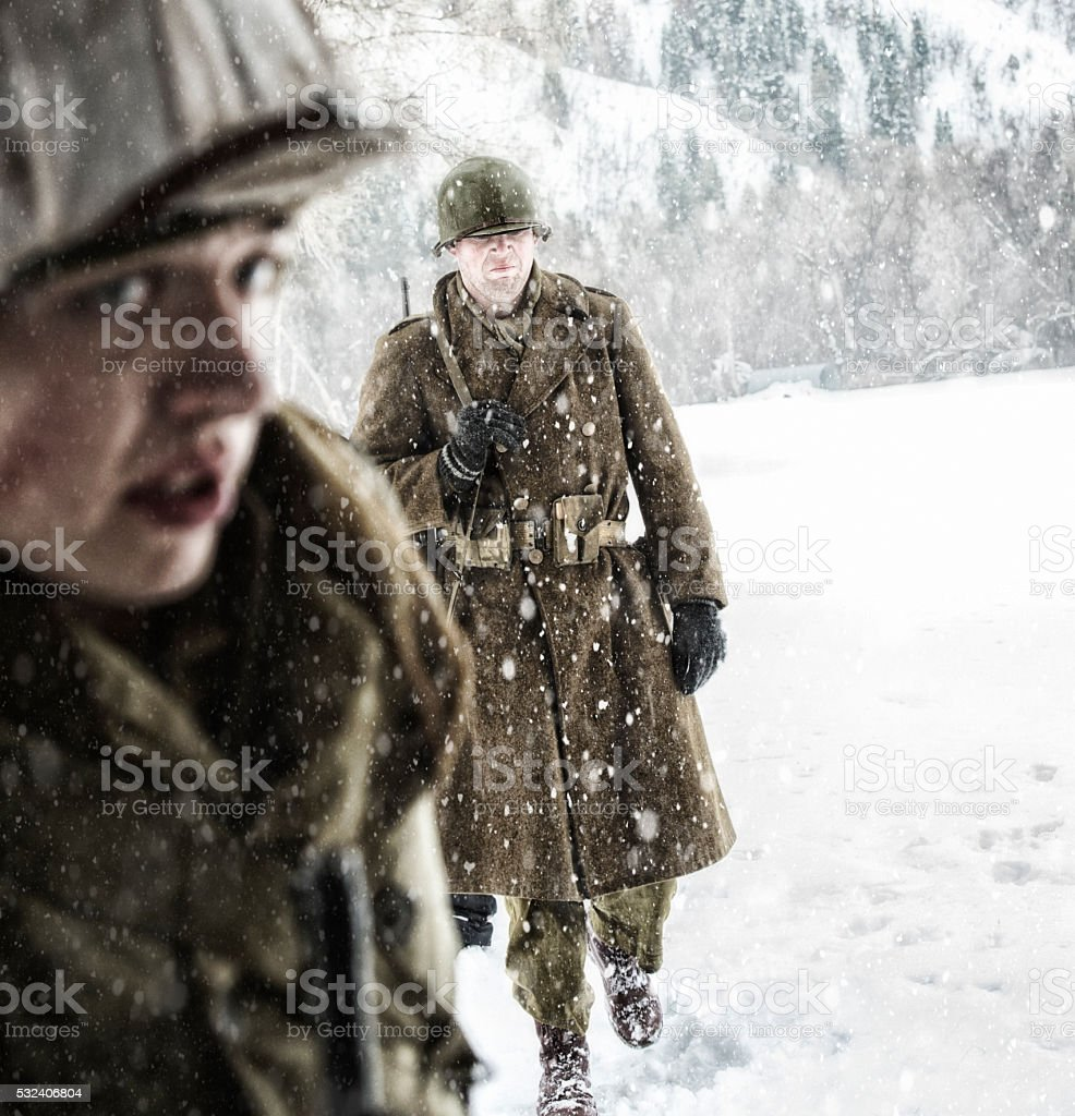 WWII US Infantry Soldiers - Cold and Wet On Patrol stock photo