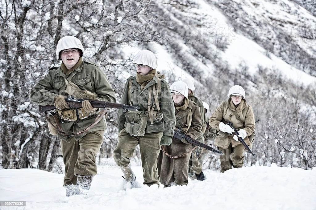 WWII US Infantry Soldiers On Winter Patrol stock photo