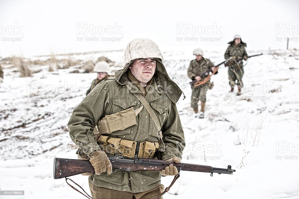 WWII US Infantry Soldiers Returning From Winter Patrol stock photo