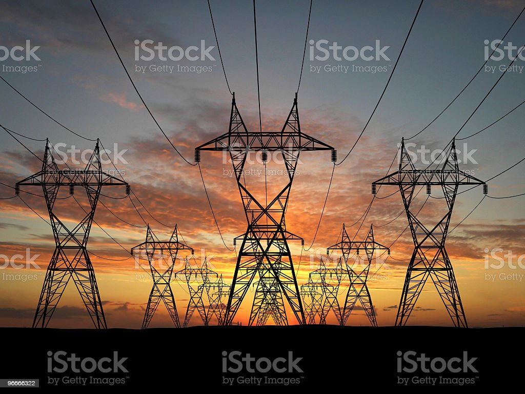 Infinite line of electric power lines at sunset stock photo