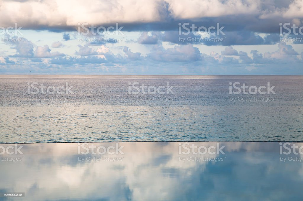 Infinity pool and clouds over the Caribbean sea stock photo