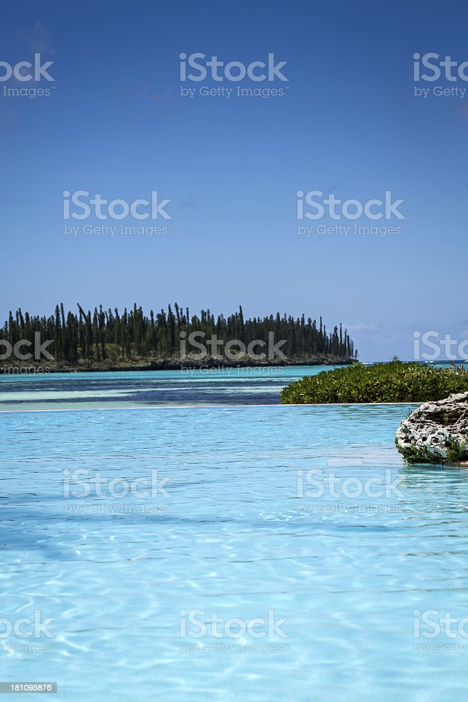 Infinity Pool at Tropical Resort on Perfect Sunny Day royalty-free stock photo