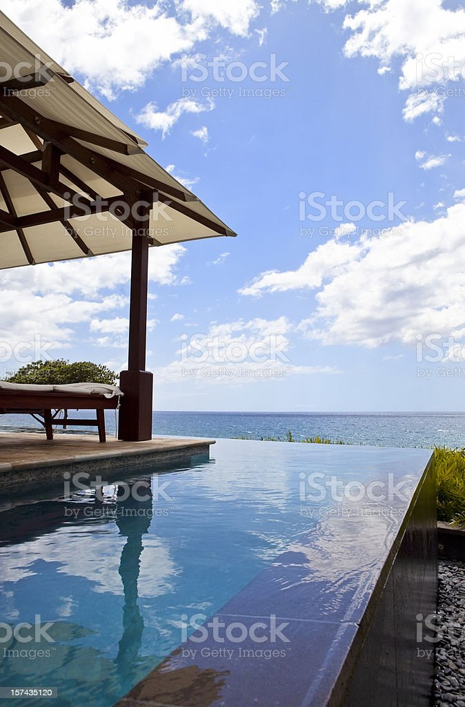Infinity Pool by the Sea (Vertical Orientation) royalty-free stock photo