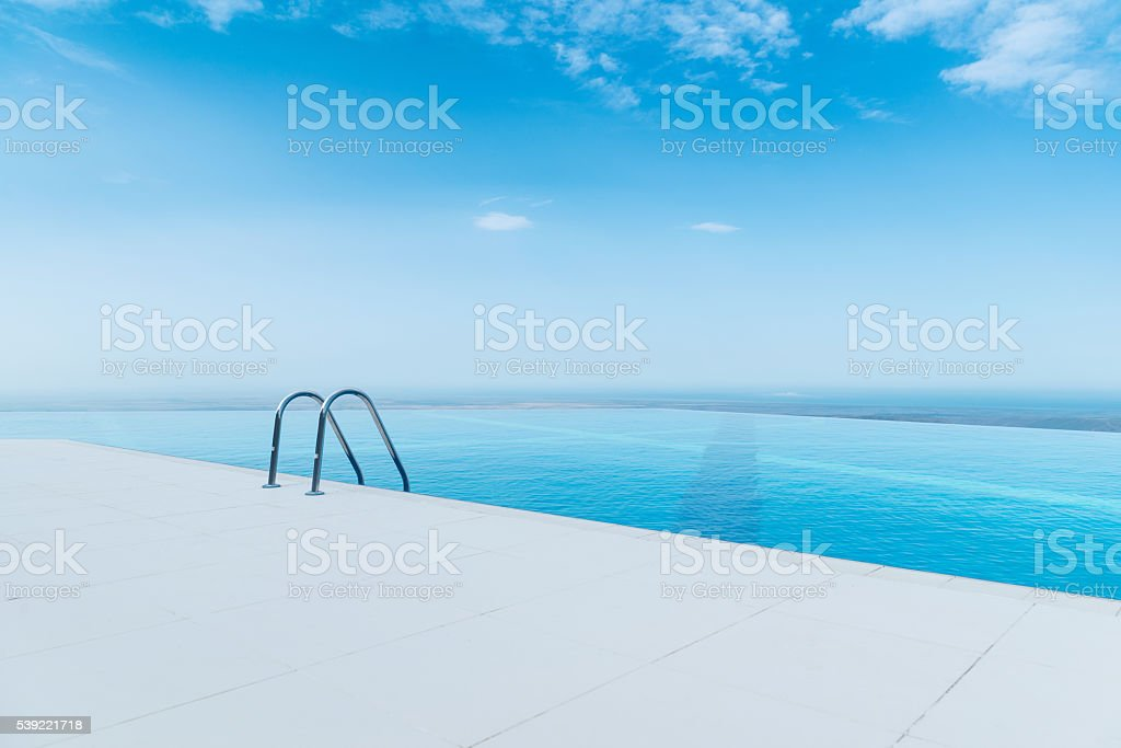 Infinity pool on the bright summer day stock photo