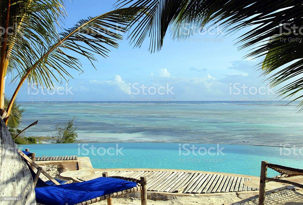 Infinity pool overlooking Indian Ocean at Kiwengwa Beach,Zanzibar,Tanzanai stock photo
