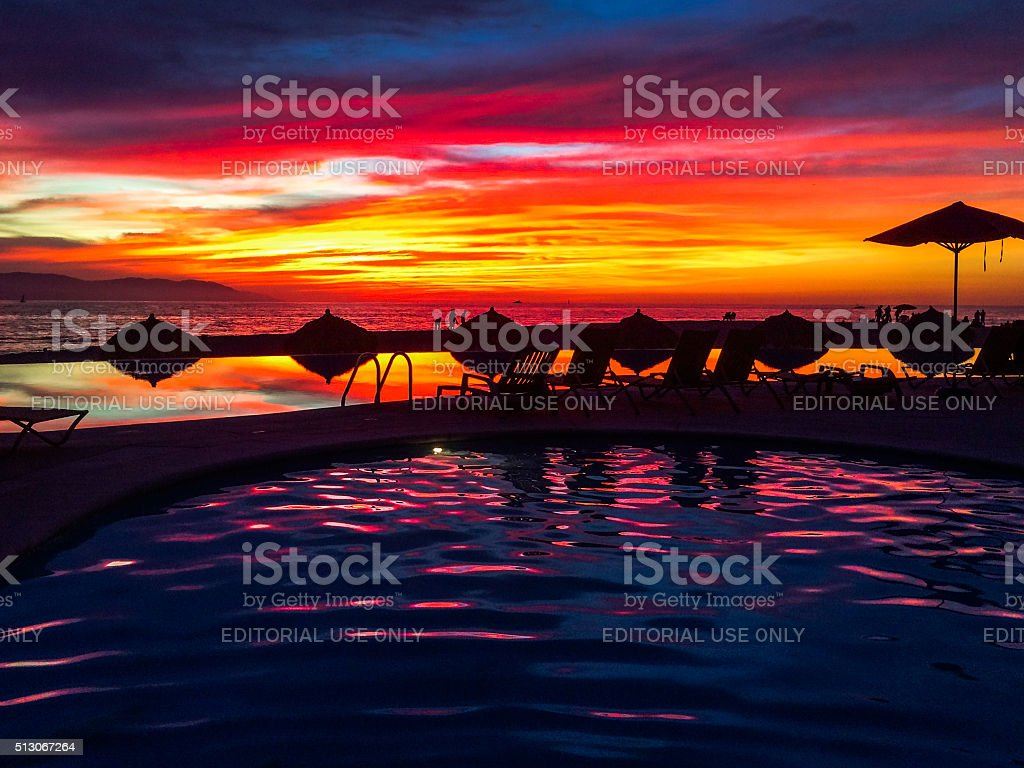 Infinity pool with colorful sunset in Puerto Vallarta, Mexico stock photo