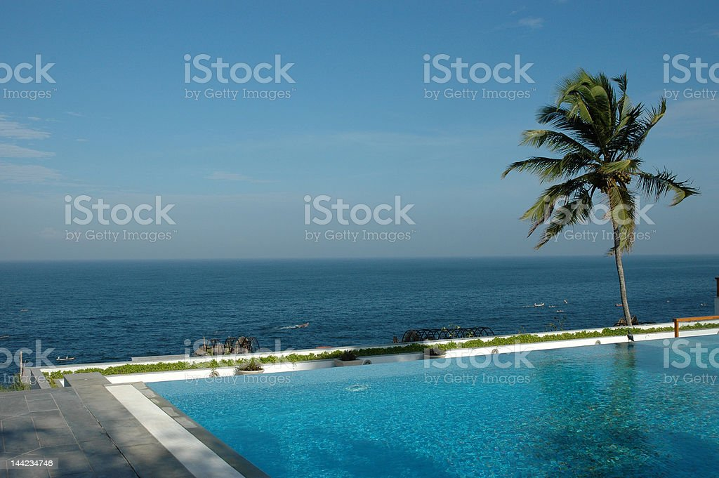 Infinity swimming pool and sea Leela Hotel Kerala southern India royalty-free stock photo