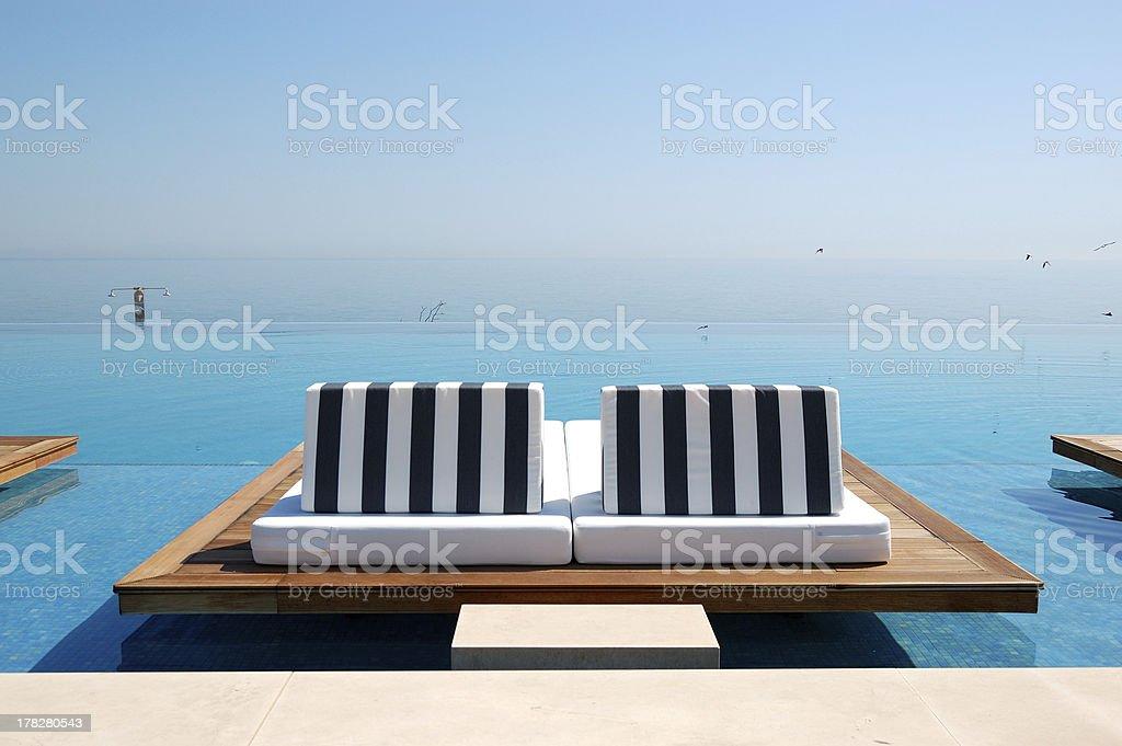 Infinity swimming pool stock photo